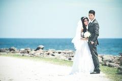 Happiness of newlywed couple at seashore Stock Photo