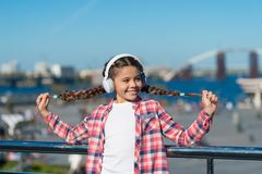 Happiness is for now. Little girl listen to music outdoor. Happy child wear headphones. Little music fan. Happy little. Girl. So start the music royalty free stock photography