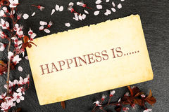 Happiness is. On paper with almond tree twig on stone texture stock images
