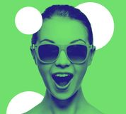 Happy amazed teenage girl in sunglasses. Happiness and people concept - portrait of happy amazed teenage girl in sunglasses, trendy duotone effect Royalty Free Stock Images