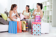 Happiness pregnant women with their shopping bags. At home Stock Photo
