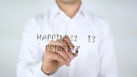 Happiness Is Priority, Writing on Glass stock photography