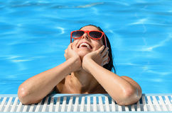 Happiness and relax on summer pool Stock Images