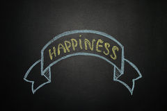 Happiness with Ribbon Banner, written with chalk on a blackboard Stock Image