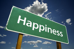 Happiness - Road Sign. On dramatic blue sky and clouds background Royalty Free Stock Photos