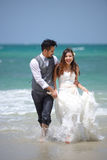 Happiness and romantic scene of love just married couple walking Stock Photos