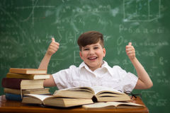 Happiness schoolboy finishing with learning Royalty Free Stock Photography
