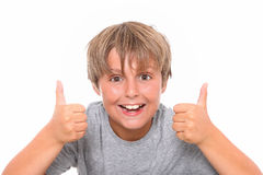 Happiness schoolboy shows OK Stock Photo