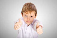 Happiness schoolboy shows OK Royalty Free Stock Images