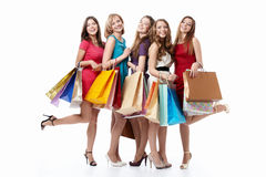 Happiness shopping. Happy attractive girl with shopping on white background Stock Photos