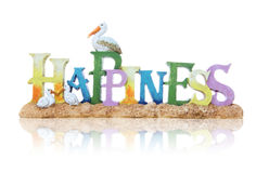 Happiness Sign. A happiness sign at the beach with sand and birds Royalty Free Stock Image