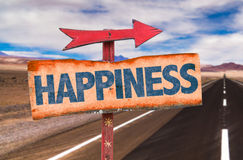 Happiness sign with road background Stock Photography