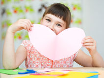 Happiness - smiling girl with pink heart Royalty Free Stock Images