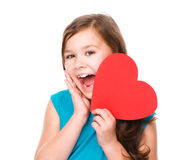 Happiness - smiling girl with red heart Stock Image