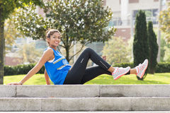 Happiness sporty woman exercising and training in the park. Royalty Free Stock Photography