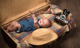 Happiness. Sweet little baby. New life and birth. Small girl in suitcase. Traveling and adventure. Family. Child care. Portrait of happy little child stock photo