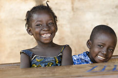 Happiness Symbol: Couple of African Children Laughing at School. Cool children laughing sitting in their desk in Bamako, Mali Stock Images