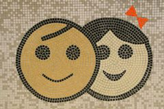 Happiness tiled. Two kids graphics on a tile wall Royalty Free Stock Images