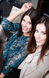 Happiness of two girlfriends with long dark hair. After shopping happiness of two girlfriends with long dark hair Royalty Free Stock Image