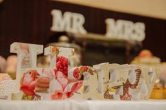 Happiness. Wedding. Arrange the bride`s table Royalty Free Stock Photos