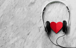 Happiness, Wellness concept. Top view of Red heart and headphone Stock Image