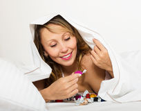 Happiness woman eating chocolate candy Stock Image