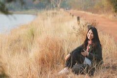 Happiness woman enjoy sit at grassland Stock Photography