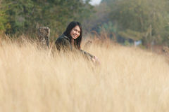 Happiness woman enjoy sit at grassland Royalty Free Stock Images