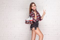 Happiness woman holding quads and showing peace sign. Studio shot Stock Photo