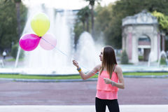 Happiness woman playing balloons in the park. Stock Photo