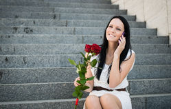 Happiness - woman with roses Stock Photo
