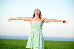 Happiness woman stay outdoor under sunlight of Stock Images