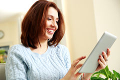 Happiness woman using tablet computer Stock Photography