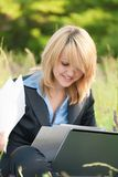 Happiness woman working on nature with documents royalty free stock images