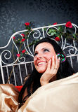 Happiness women on vintage bed Royalty Free Stock Photo