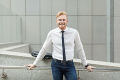 Happiness young adult success businessman, looking at camera and toothy smile. Outdoor shot in summer Royalty Free Stock Photo