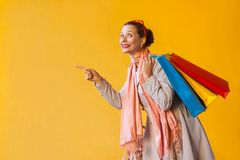 Happiness young adult woman pointing finger on copy space and lo Royalty Free Stock Photo