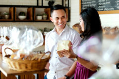 Happiness of young couple shopping at bakery shop Royalty Free Stock Photography