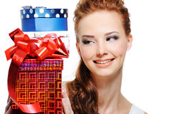 Happiness of a young girl with presents Stock Image