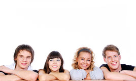 Happiness young guys and girls. Portrait of four happiness young guys and girls isolated on white Stock Images