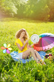 Happiness young woman with clock in the park Stock Photos