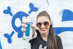 Happiness young woman enjoy graffiti spray paint. Stock Photography
