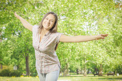 Happiness young woman enjoyment in the nature Royalty Free Stock Photo