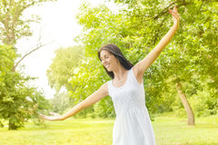 Happiness young woman enjoyment in the nature Stock Photo