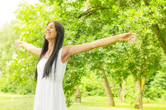 Happiness young woman enjoyment in the nature. Happiness young woman with sprading hands enjoyment in the nature and beautiful day Royalty Free Stock Photo
