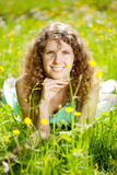 Happiness young woman in field of flowers Royalty Free Stock Photos