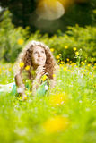 Happiness young woman in field of flowers Stock Image