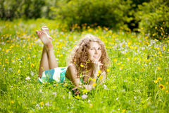 Happiness young woman in field of flowers Stock Photo