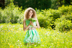 Happiness young woman in field of flowers Royalty Free Stock Image