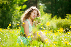 Happiness young woman in field of flowers Stock Images